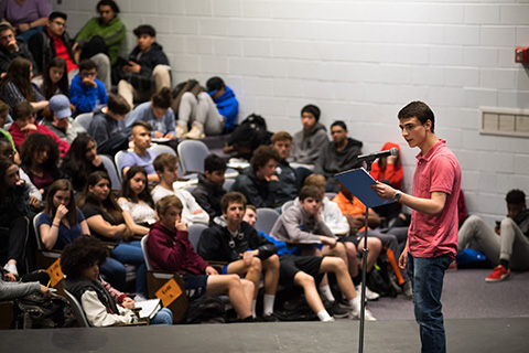a photo of a student performing poetry